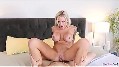 Busty MILF riding and deepthroating cock