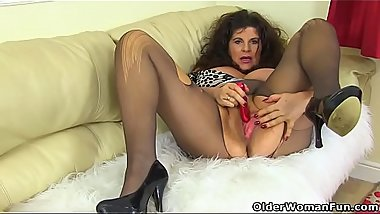 English milf Gilly pleases her big knockers and fine fanny