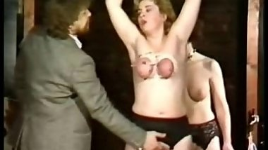 Milf slave with her tits tied together and large needles in it got finger fucked