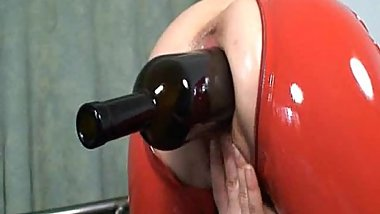 Huge wine bottle stretches her loose cunt