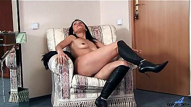 Anilos Nelli reveals sultry breast and rubs her milf pussy