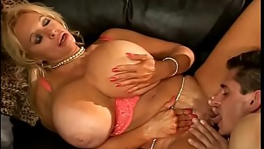 Busty blond MILF with gigantic melons Echo Valley gets cunt sucked and fucked on couch