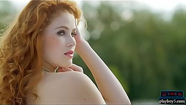 Naturally curved Redhead beauty strips off her bikini
