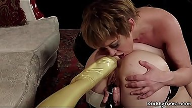 Domme in latex stockings gives anal foot sex