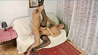 MILF and young guy fuck on couch