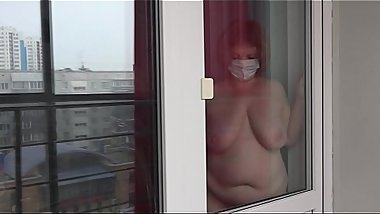 Lesbian peeps out the window for how fat milf with huge tits and with a big ass washes the window and undresses. Voyeur.